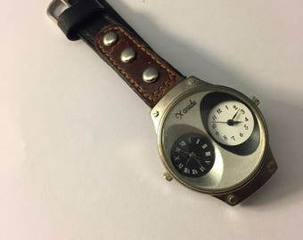 90's Xanadu double Dial watch, retro modern, brown and black leather wrist bands, two dials thin bands. Needs new battery.