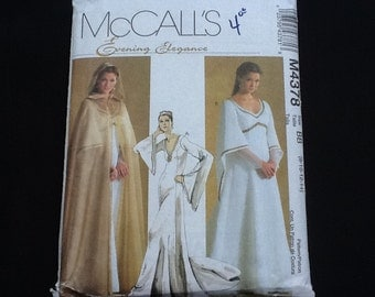 McCall's pattern 4378. Uncut misses' floor length, V neck dress with train and sleeve variations. Full length hooded cape. Sizes 8-14.