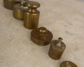 Set of 6 antique brass weights 4g to 200g