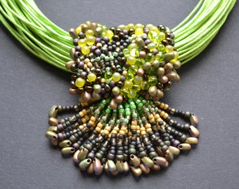 Wide beaded necklace with pendant