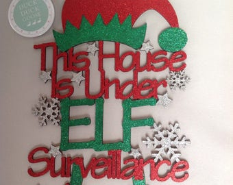 Hat & Feet Elf Surveillance Plaque by Duck Duck Goose