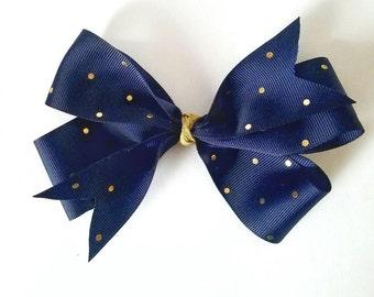 Navy and gold polka dot bow!