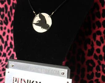 Acrylic crow silhouette necklace