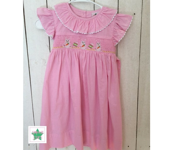153d98306 Sweet Smocked Easter Bunny with Eggs Dress on a beautiful pink check fabric  with white ric-rac on the sleeves and ...