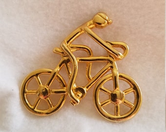 Bicycle brooch with rider. Cycling