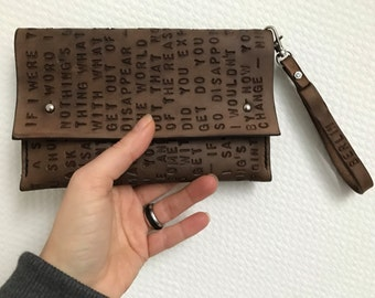 Hand stitched hand stamped brown vegetable tanned leather small clutch