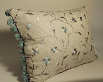 Handmade Cushion in Clarke and Clarke duckegg floral embroidered fabric with bobbles.  The cushion is backed in a  duckegg cotton fabric