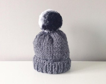 chunky hand knitted bobble hat with marble effect pompom