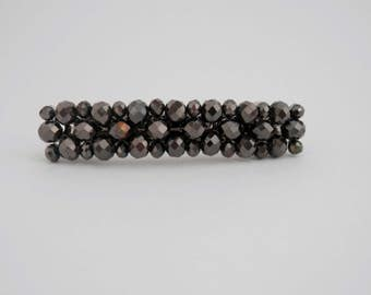 Medium barrette with metallic gunmetal crystals