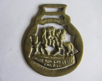 Antique or vintage horse brass. Widecombe Fair Devon Uncle Tom Cobbley and All Nursery rhyme. Cast brass harness decoration