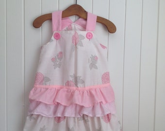 Size 1 Toddlers Summer Dress/Overall with bottom frills and shoulder straps.