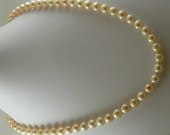Fresh Water Semi Round Light Pink Pearl Necklace 8.7mm 14k Yellow Gold Clasp