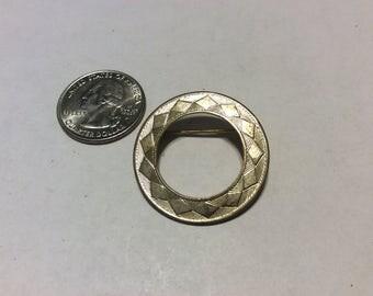 Vintage gold tone engraved circle pin badn