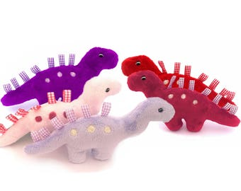 Dinosaur taggy toys. Pinks and purples. Party bag toys. Cuddly dinosaur.  Handmade dinosaur. .Plush dinosaur by Exclusively Handmade.
