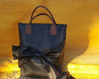 Bag with leather loop