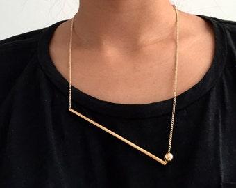 Balanced bar ball necklace