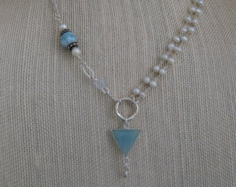 Handmade asymmetrical necklace with lovely cool blues of larimar and chalcedony with white pearls and silver