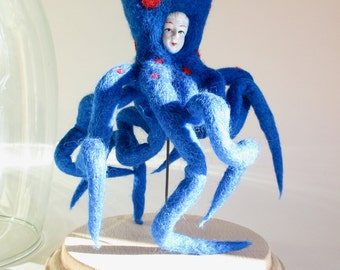 Octopus, blue felted wool, with a human face