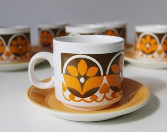 1970s Staffordshire Potteries orange floral tea cups and saucers - flower power