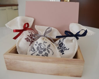 Cross stitch-embroidered linen scented bags with flowers