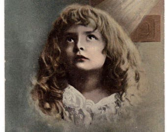 Antique 1910 Eastertide kind thoughts girl looks to heaven cross victorian postcard