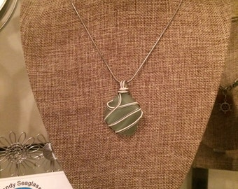 Aqua blue Sea glass with silver and white copper wire wrapped with black cord