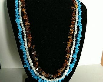 Lee Sands Necklaces are made of, Tiger Eye, Turquoise and Fresh Water Pearls
