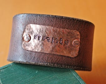 "leather and brass ""Resist"" bracelet"
