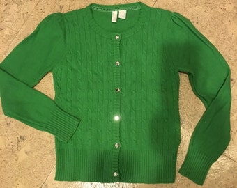 Girls 1990's emerald colored cable knit cardigan sweater.
