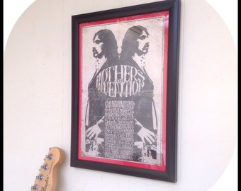Aged reproduction vintage Frank Zappa Mothers of Invention gig poster in frame.