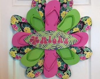 "23"" Summer Hibiscus Flower Flip Flip Wreath with ""Aloha"" Sign - Pink/Green/Black"