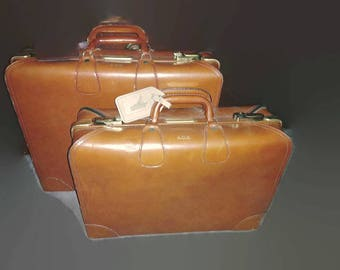 Pair suitcases cow hide leather by Diamond Leathercraft