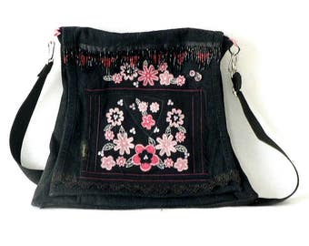 Black handmade appliqued recycled bag.Denim jeans.Silki aplication in bloom. Very useful and unique design.