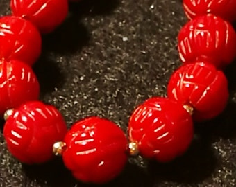 Natural dyed coral necklace and gold beads