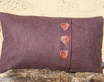 Rectangular wool fabric cushion with heart shaped ceramic buttons