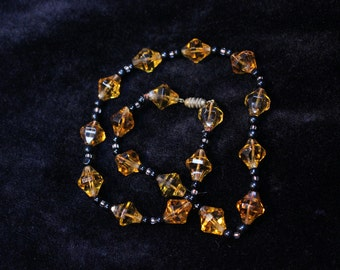 1930s or earlier amber glass bead necklace with original brass clasp