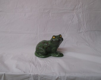 a small ceramic bisque frog