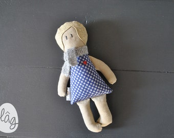 Blonde doll in a dress with polka dots