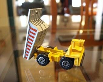 """1989 Matchbox Yellow Dump Truck – Die cast – Loose – 2.75"""" long"""