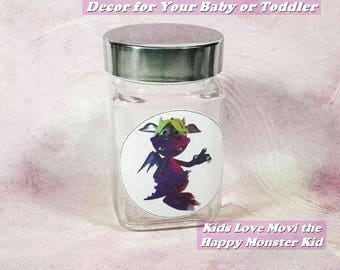 """Toddlers' or Baby's Nursery Decor-'Movi' the Happy Monster Kid-Glass Storage Jar. 3.75"""" Square x 4"""" High. Beautiful New Baby or Shower Gift!"""
