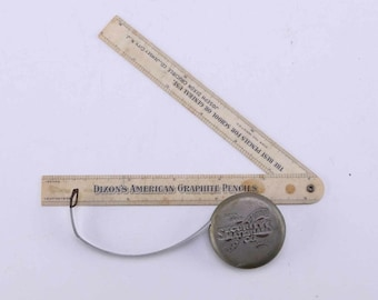 A Circa 1907 Hinged Ruler and Lufkin retractable measuring tape