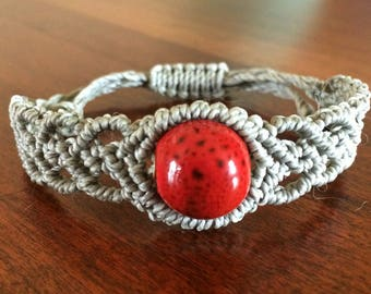 Stackable bracelet with red center bead