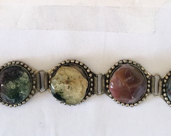 Bracelet with agate stones on white metal