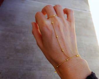 Gold beaded satellite hand chain slave bracelet