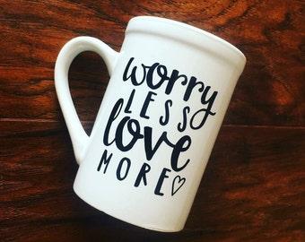 Worry less, love more mug | white 14 ounce ceramic mug with black vinyl design