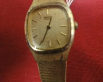 Ladies all gold SEIKO 5gpst gold face and gold w/band watch