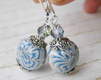 Earrings with blotches of gray- blue polymer clay light blue silver tone accessory