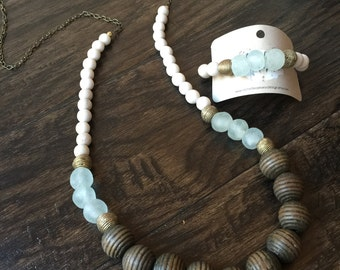 Statement necklace with tones of cream, brown, gold and mint