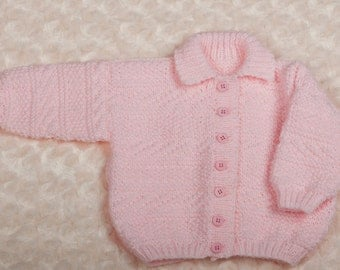 Hand knitted pink girl's collared cardigan