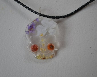Resin Skull Necklace with real plants and flowers on a leatherlook (Not leather) choker